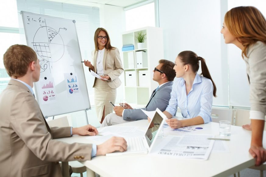 13729495 - confident top manager standing by the whiteboard and explaining her strategy at meeting